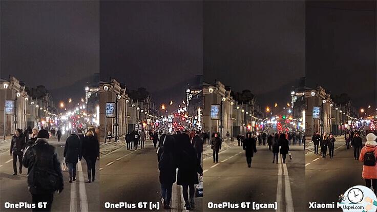улица, уходящая вдаль, много источников света от автомобилей