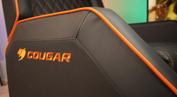 Скошенные грани, острые углы, цветные вставки и большой вышитый логотип с каждой стороны.